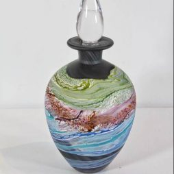 Sea shore-Stormy skies round stoppered bottle by Thomas Petit