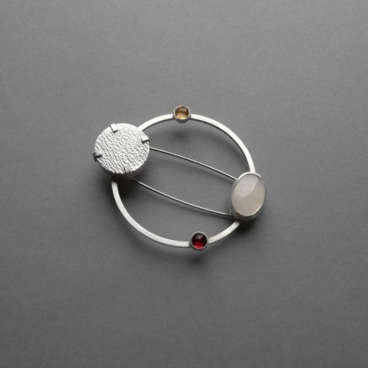 Ripple brooch with gemstones by Rebecca Halstead