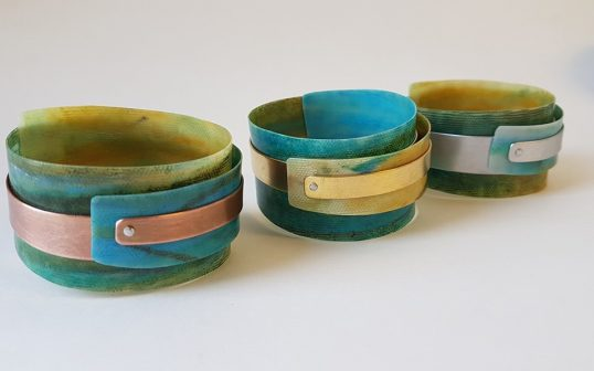 Cuffs with copper or brass by Anna Roebuck